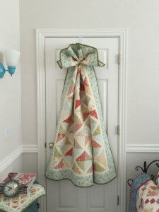 Single Quilt displayed on hook