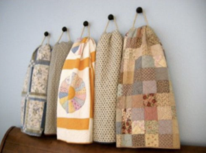 Quilts displayed on hooks
