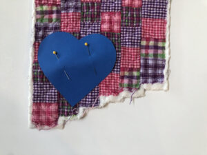 Pin heart to quilt